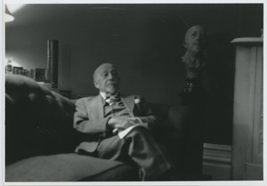 W. E. B. Du Bois sitting on the couch in his Brooklyn home