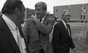 Ceremonial groundbreaking for the Conte Center: unidentified man, Gov. William Weld, and or Richard O'Brien walking to the site of groundbreaking