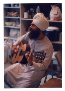 Gurushabd Singh playing guitar