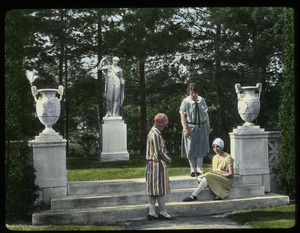A. H. Dakin garden (women gathered on stone steps near urns and statue)