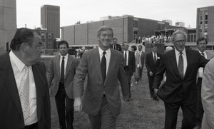 Ceremonial groundbreaking for the Conte Center: Gov. William Weld walking to the site of groundbreaking, Provost Richard O'Brien to his left