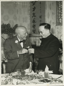 W. E. B. Du Bois, toasting with Guo Moruo at 91st birthday celebration