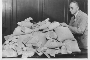 Philip H. Smith with bags of vegetable seeds
