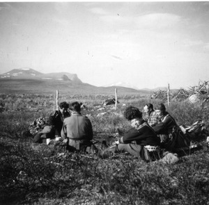Campers in a field in Lapland