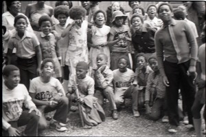 Inner City Round Table of Youth campers: group of African American children at summer camp, some wearing Spirit in Flesh t-shirts, posed in front of camp building