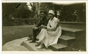 Lawrence D. Yeomans, in uniform, seated on steps with unidentified nurse