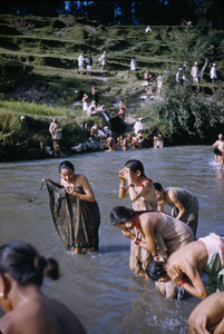 Women bathe at Father's Day Festival