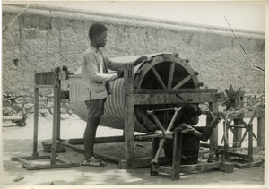Chinese boy and girl working with loom