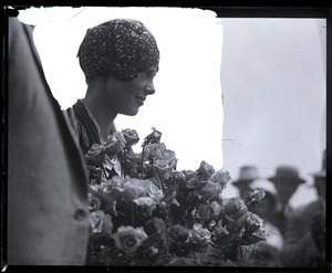 Amelia Earhart reception: close-up of Earhart with bouquet of flowers