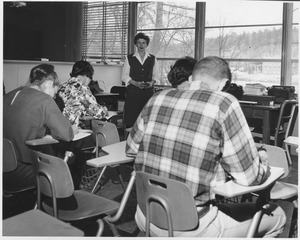 Marjorie Rodgers standing in classroom with unidentified students