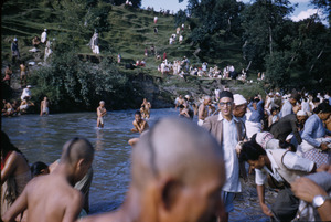 Priests and others bathe in river