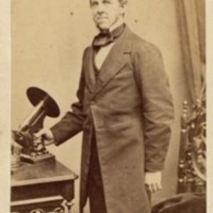 Oliver Wendell Holmes with his microscope