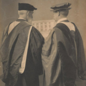 Drs. Henry P. Bowditch and J. Collins Warren holding a picture of the Longwood campus