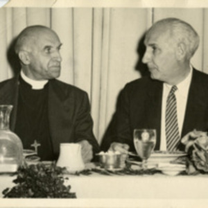 Alan Guttmacher with a priest