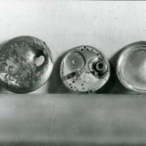 Photograph of pocket watch with bullet hole, 1920.