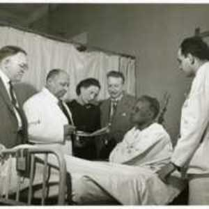 Louis T. Wright and colleagues at patient bedside, Harlem Hospital, New York, N.Y.