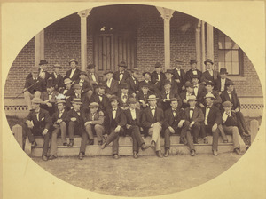 Class of 1871 members gather on the steps of North College