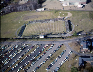 Aerial view of football field and parking lot