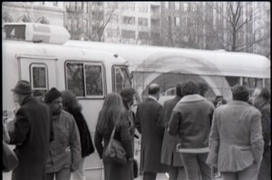 By-standers milling outside Free Spirit Press bus near Central Park