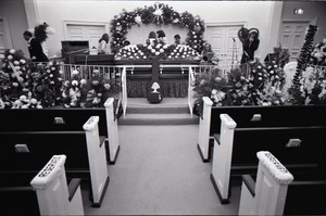 Duane Allman's funeral: musicians setting up with Duane Allman's casket in foreground, from left: Jaimoe, Barry Oakley, Delaney Bramlett, Dickey Betts, Butch Trucks, and Thom Doucette