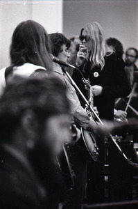 Duane Allman's funeral: Gregg Allman smoking a cigarette, with Dr. John in the foreground, Barry Oakley (l) and Dickey Betts (c)