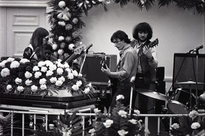 Duane Allman's funeral: Allman Brothers Band performing, from left, Barry Oakley, Jaimoe, Delaney Bramlett, and Dickey Betts, with Allman's casket in the foreground