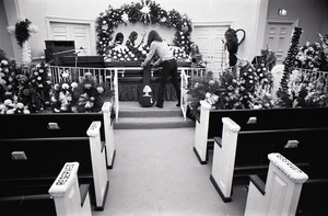 Duane Allman's funeral: musicians setting up with Duane Allman's casket in foreground, from left: Delaney Bramlett, Barry Oakley, Butch Trucks, and Thom Doucette