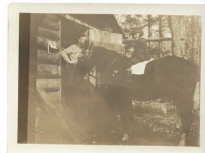 Young girl on horse at Cellar Rats cabin in Maine