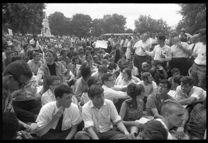 Anti-Vietnam war protesters sitting down after Assembly of Unrepresented People peace march