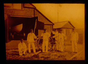Men in White Standing Beside Cart