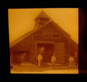Three Men in White Standing on Doors of Station