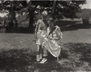 Dorothy Thompson seated on the lawn with son Michael Lewis