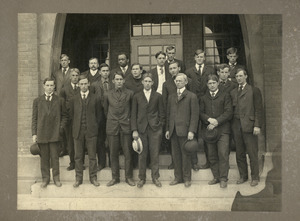 Class of 1906 students: group portrait on stairs of unidentified building