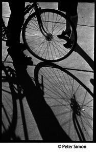 Bicycle and shadows on a sidewalk, Boston University