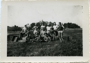 Duxbury Cranberry Company: German prisoners of war from Camp Edwards (Cape Cod) harvesting cranberries, posed with hand scoops and crates