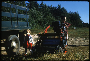Becky and Fred Cann with Western picker and bog truck, Duxbury Cranberry Company