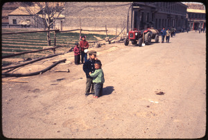 Children in road, tractor