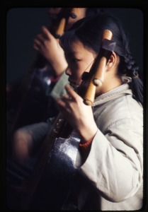 Children's Palace -- girl playing instrument