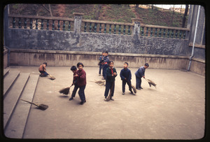Children sweeping courtyard at Normal College