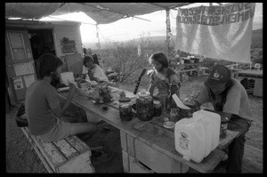 Activists eating at a makeshift table at the Nevada Test Site peace encampment