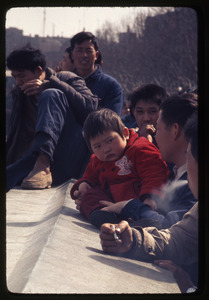 Child at bridge, man smoking, informal