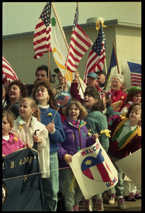 Crowd with flags greeting the USS Roberts returning from Persian Gulf War duty