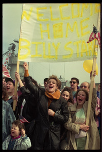 Ecstatic family with banner 'Welcome home Billy Stare,' as the USS Roberts returns from Persian Gulf War duty