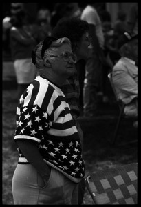 Older woman in American flag sweater watching the Chesterfield's Fourth of July parade