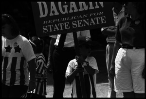 Child holding a sign 'Dagarin Republican for State Senate' at Chesterfield's Fourth of July parade