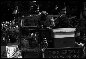 Chesterfield Grange float with beehives, a calf, and ducks at Chesterfield's Fourth of July parade