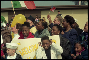 Crowd with welcome banners greeting the USS Roberts returning from Persian Gulf War duty