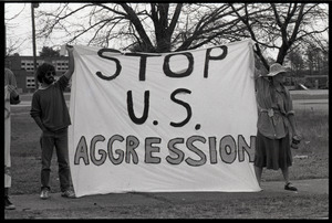 Protests against U.S. intervention in Nicaragua at Westover Air Force base: two protesters holding a banner reading 'Stop U.S. aggression'