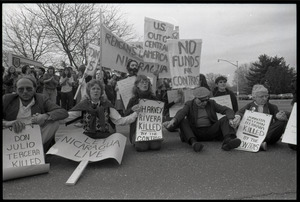 Protests against U.S. intervention in Nicaragua at Westover Air Force base: protesters seated on the pavement, including Frances Crowe (far right)