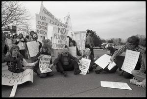 Protests against U.S. intervention in Nicaragua at Westover Air Force base: protesters seated on the pavement, including Frances Crowe (third from right)